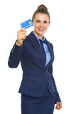 Smiling business woman showing credit card Stock Photography