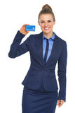 Smiling business woman showing credit card Royalty Free Stock Image