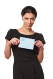 Smiling business woman showing envelope Stock Photos