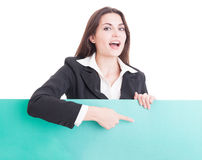 Smiling business woman showing a green empty cardboard Royalty Free Stock Photography