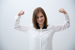 Smiling business woman showing her strength Royalty Free Stock Image