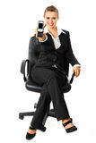 Smiling business woman and showing mobile in hand Stock Images