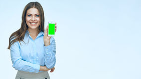 Smiling business woman showing mobile phone screen. Isolated studio portrait Stock Photo