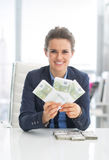 Smiling business woman showing money packs Royalty Free Stock Image