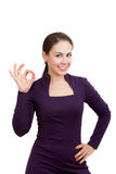 Smiling business woman is showing a Ok gesture Stock Photo