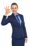 Smiling business woman showing ok gesture Stock Photo
