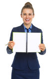 Smiling business woman showing open notepad Stock Image