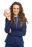 Smiling business woman showing piggy bank Royalty Free Stock Photos