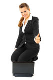 Smiling business woman showing thumbs up gesture Royalty Free Stock Image