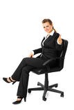 Smiling business woman showing thumbs up gesture Royalty Free Stock Images