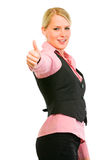Smiling business woman showing thumbs up gesture Stock Image