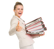 Smiling business woman showing thumbs up Stock Image