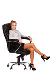Smiling business woman sitting in chair. Stock Photos