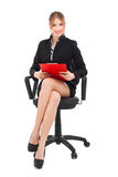 Smiling business woman sitting on a chair Royalty Free Stock Image