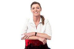 Smiling business woman sitting on the chair Stock Image