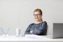 Smiling business woman sitting at office Desk and working with l Stock Images