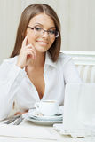 Smiling business woman sitting at table, close-up Royalty Free Stock Photos