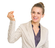 Smiling business woman snapping fingers Royalty Free Stock Photos