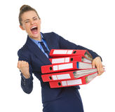 Smiling business woman with stack of documents Royalty Free Stock Photo