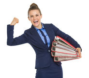 Smiling business woman with stack of folders Royalty Free Stock Images