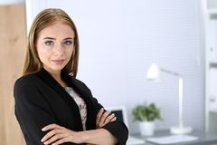 Smiling business woman standing at her office Stock Photography