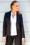 Smiling business woman standing near office Royalty Free Stock Photo