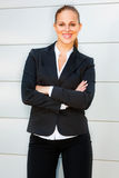 Smiling business woman standing at office building Royalty Free Stock Images