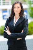 Smiling business woman standing outdoor Stock Photo