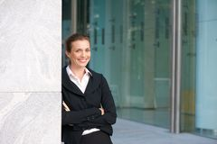 Smiling business woman standing outside office building Royalty Free Stock Photos