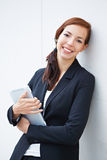 Smiling business woman with tablet Stock Images
