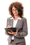 Smiling business woman with tablet pc Royalty Free Stock Image
