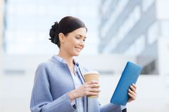 Smiling business woman with tablet pc in city Stock Photo
