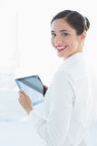 Smiling business woman with tablet PC in office Royalty Free Stock Photo