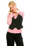 Smiling business woman talking on cell phone. And pointing on you isolated on white Stock Images
