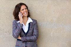 Smiling business woman talking on cell phone. Close up portrait of a smiling business woman talking on cell phone Royalty Free Stock Photography