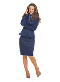 Smiling business woman talking mobile phone Stock Image