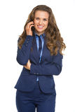 Smiling business woman talking mobile phone Royalty Free Stock Image