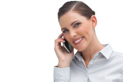 Smiling business woman talking on mobile phone Royalty Free Stock Photography