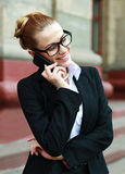 Smiling business woman talking on mobile phone Royalty Free Stock Photos