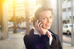 Smiling business woman talking on mobile phone Stock Photos