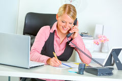 Smiling business woman talking phone Stock Photos