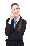Smiling business woman thinking Royalty Free Stock Photos