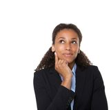 Smiling business woman thinking Royalty Free Stock Photography