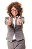 Smiling business woman thumb up Stock Photo