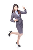 Smiling business woman with thumbs up Stock Photography