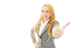 Smiling business woman with thumbs up stock image