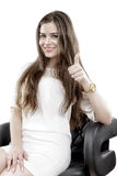 Smiling business woman with thumbs up gesture Stock Photo