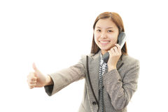 Smiling business woman with thumbs up Royalty Free Stock Photos