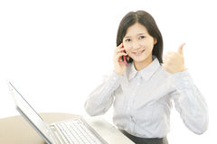 Smiling business woman with thumbs up Stock Images