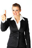 Smiling business woman touching abstract screen Royalty Free Stock Photos
